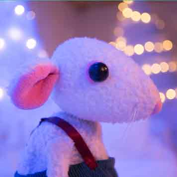 Snow Mouse puppet in a snowy forest