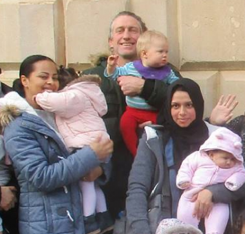 a photo of families from the trip, outside Bristol Old Vic